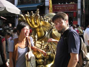 Ryan and our friend Sunshine touch a golden Buddha which is suppose to bring them good luck.