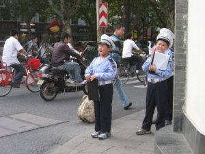 We saw these kids dressed up on the streets of Hnagzhou. They were counting cars or something and not actually doing law enforcement....I think.