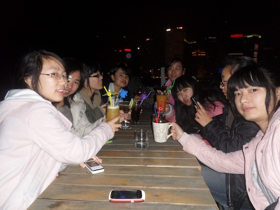A group of girls (all around 22-23 years of age) trying their first sips of alcohol at Captain's Bar in Shanghai. Some, who ordered sweet mixed drinks, enjoyed it, while others, like the girl who ordered straight gin, did not.