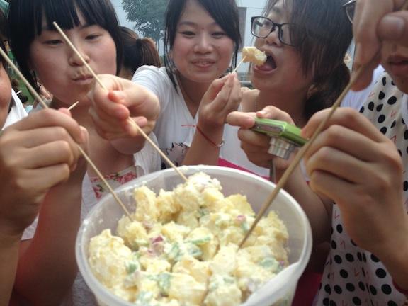 My darling students eating the potato salad I made. Yuuuum.