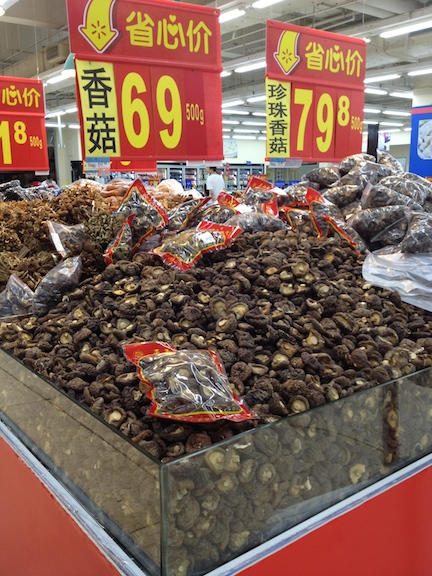 There are a lot more open bins in China, with everything from candy to beans to dried fruit. This is a bin of dried mushrooms you can pick at freely.