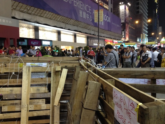 In Mong Kok the people erected barriers to prevent cars and buses (and the police) from being able to drive on the street.
