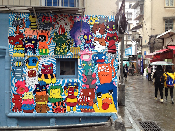 """In my wanderings I came across """"cat street"""" a place totally kitted out with kitty cats. They have some cute cafes and shops too, but even just the key maker and the noodle shop are painted festively with cats."""