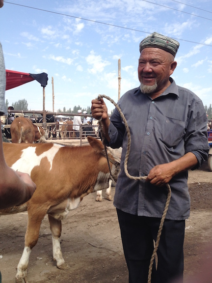 A local Uighur wearing the ornately stitched Dopa hat special to Xinjiang.