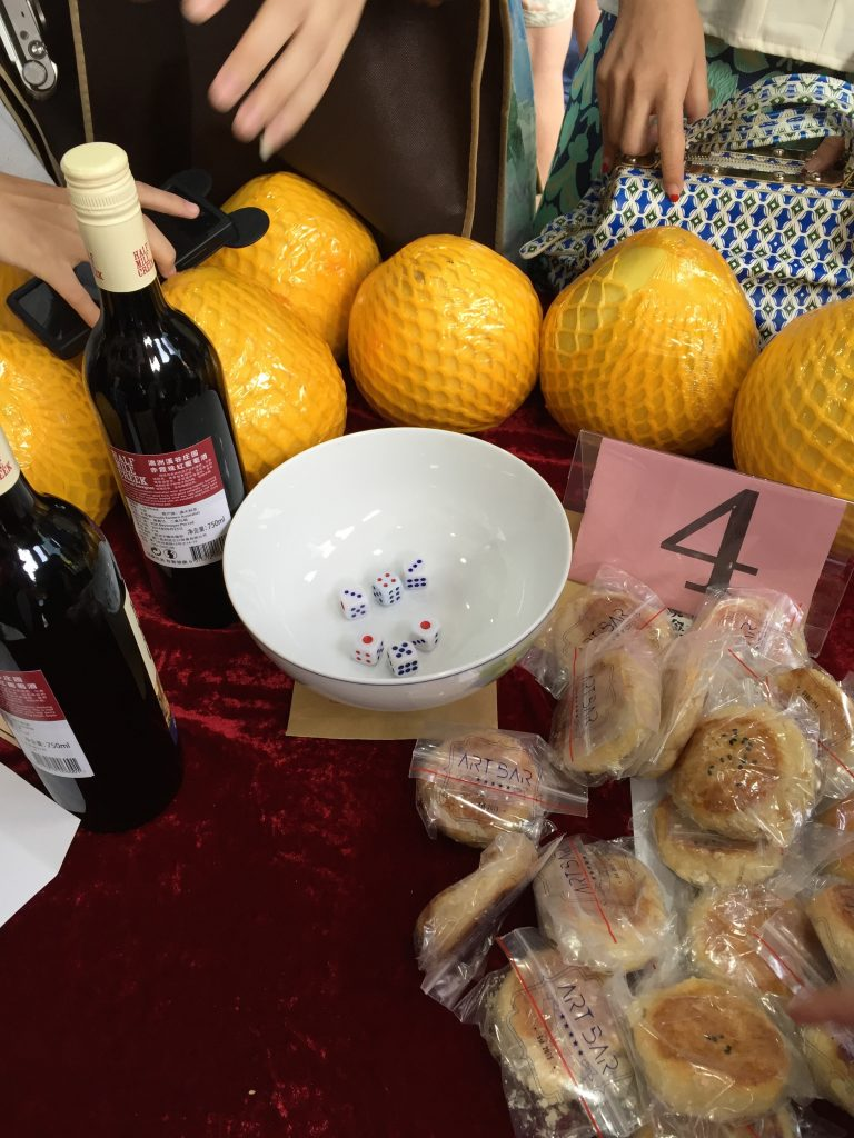 The prizes are often arranged at the bobing tables. Needless to say while I wanted to win the wine, I ended up winning a bunch of mooncakes instead.