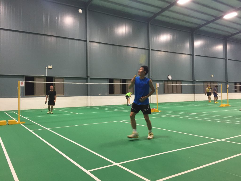 My teacher (in the blue) has amazing form. He can get across the court in three steps and seems to have an economy of movement. Every movement is so precise, every step thought out. I hope I can learn that.