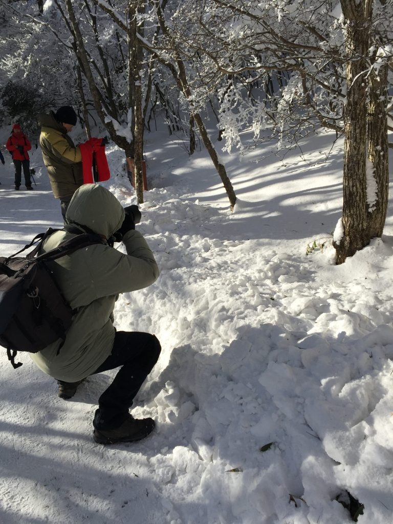 See that guy using $3000 equipment to take a picture of a reflection of a leaf on the snow? He's a good candidate to take a picture of you.